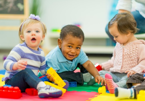 Infants and toddlers playing together at Child Care in Peoria IL