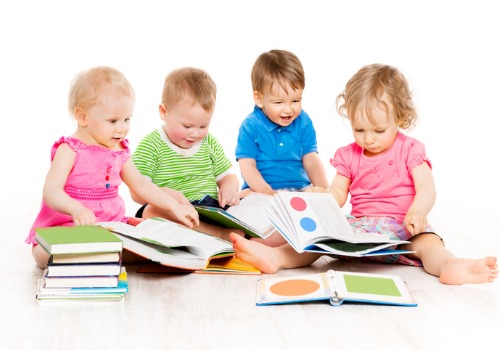 Babies looking at books and learning shapes and colors at Infant Daycare in Peoria IL