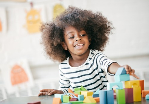 A young girl playing with blocks at a Preschool in Peoria IL