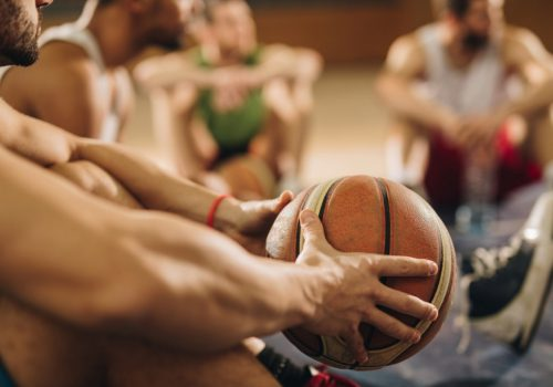 Photo of a Basketball Team Before a Match